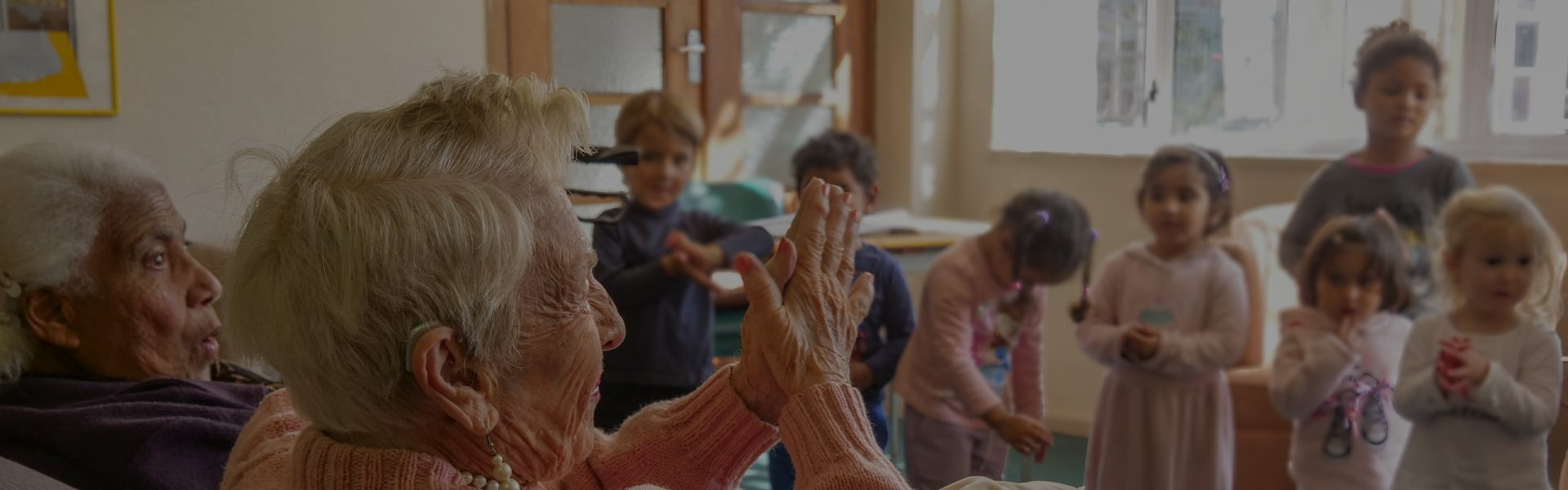 elderly woman playing with children